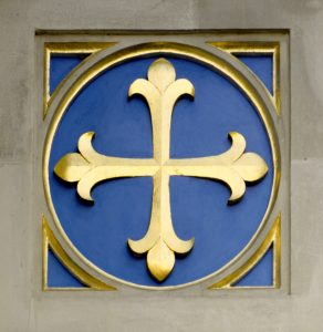 Westminster Abbey's emblem of a cross patonse, known as St Edward's Cross.