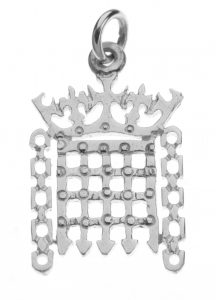 A sterling silver charm in the shape of a crowned portcullis.