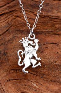 A crowned silver lion guardant pendant