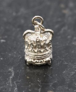 A small silver cushion crown pendant