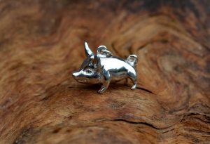 A little silver pig pendant by Mallards.